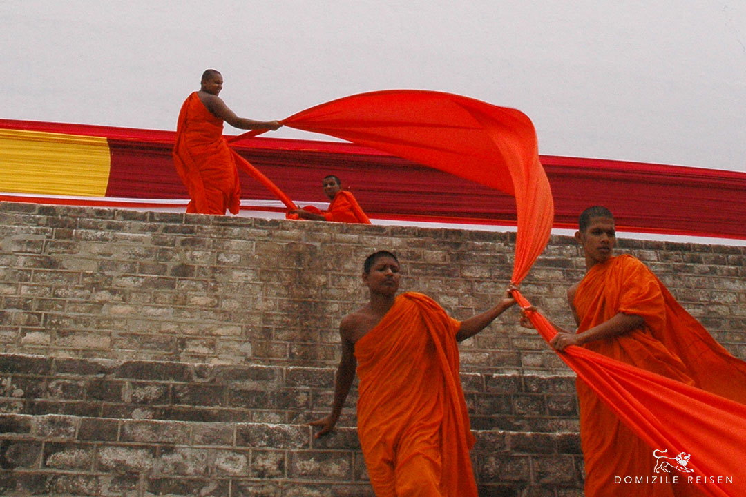 traditional red costumes on monks in Sri Lanka